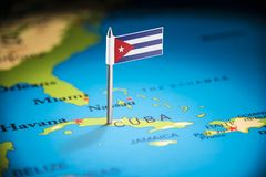 Cuba marked with a flag on the map.  stock photos