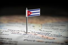 Cuba marked with a flag on the map.  royalty free stock photos
