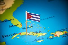 Cuba marked with a flag on the map.  stock photography