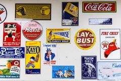 CUBA, MISSOURI - APRIL 5, 2018 - Collection of vintage metal signs and logos of former and actual companies displayed on a wall royalty free stock photography