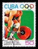 Cuba mostra o elevador de peso, 23th Jogos Olímpicos do verão, Los Anbgeles 1984, EUA, cerca de 1984 Imagem de Stock