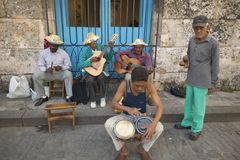 Cuba musicians playing music on streets at Catedral de la Habana, Plaza del Catedral, Old Havana, Cuba Stock Photo