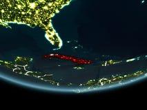 Cuba na terra do espaço na noite Imagem de Stock
