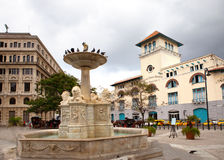 Cuba. Old Havana. Sierra Maestra Havana and fountain of lions on San Francisco Square Stock Photography
