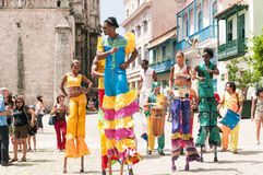 Cuba - Old Havana. Street Artists on stilts dancing, singing and playing with costumes Caribbean stock images