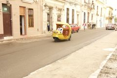 CUBA OLD HAVANA STREET SCENE WITH COCO TAXI Stock Images
