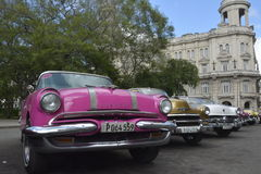 CUBA OLD HAVANA STREET SCENE WITH VINTAGE CARS Stock Photos