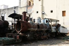 Cuba: Old trains behind the Capitolio in Havanna. Cuba: Old train components are being restored for the railway museum in Havanna-City stock photo