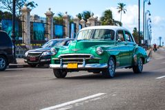 Cuba Oldtimer traveling on the promenade Malecon in Havana Stock Photos