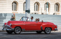Cuba orange american cabriolet Oldtimer on the street in Havana city Stock Image