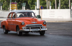 Cuba orange american Oldtimer drives in the city from Havana Royalty Free Stock Photography