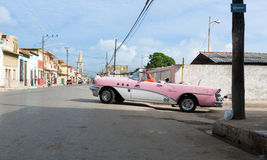 Cuba pink american classic car drives on the street in Varadero Stock Images