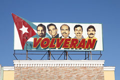 Cuba propaganda. CIENFUEGOS, CUBA - FEBRUARY 3: Propaganda billboard in the street on February 3, 2011 in Cienfuegos, Cuba. The billboard depicts five Cubans Royalty Free Stock Images