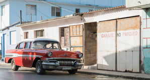 Cuba red american classic car parked in the countryside for a building Royalty Free Stock Images