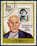 CUBA - 1981: shows Pablo Picasso (1881-1973), artist, birth centenary, and postage stamp shows The Man with the Pipe, by Picasso Royalty Free Stock Photos