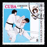 Cuba shows two fighting judoists, Summer Olympic games in Moscow, circa 1980 Royalty Free Stock Photography