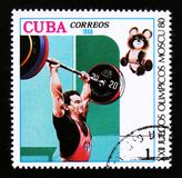 Cuba shows weight lifting, Summer Olympic games in Moscow, circa 1980 Royalty Free Stock Photography