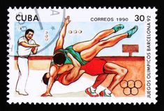 Cuba shows wrestlers, series devoted to the 25th summer Olympic games in Barcelona 1992, circa 1990 Stock Photos
