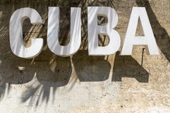 Cuba sign. Standing on a wall in Havana, Cuba stock photography