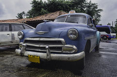 Cuba. Street scene with old taxi. Stock Images