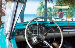 Cuba Varadero american blue Oldtimer parked on the beach with interior Royalty Free Stock Images