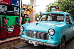 Cuba Varadero american blue Oldtimer parked at the gas station Stock Images