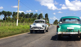 Cuba yellow classic cars on the road Royalty Free Stock Photos