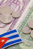 Cuban banknotes and coins on the table. Stock Photography