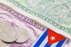 Cuban banknotes and coins on the table. Royalty Free Stock Images