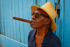 Cuban with a big cigar in his mouth. Cuban with big cigar in hih mouth on Havana street Stock Photos