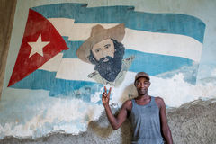 Cuban boy with cuban flag. With national hero picture on it Stock Images
