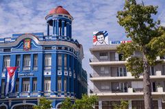 Cuban buildings with flag and Che Guavera. Buildings in Camaguey, Cuba with Che Guavera poster and Cuban flag symbolizing the Cuban revolucion Stock Photo