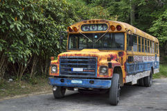 Cuban Bus. A colourful american old schoolbus parked in Guantanamo, cuba stock image