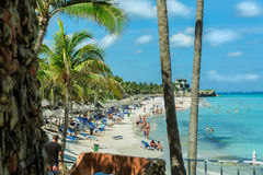 Cuban busy beautiful beach with people swimming in the ocean Royalty Free Stock Photography