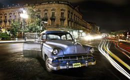 Cuban Car. Night view of Class American Car at Old Havana, Cuba. With traffic trails Royalty Free Stock Images