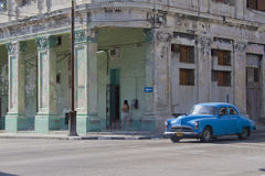 Cuban car waiting at street corner. Havana, Cuba - December 25, 2010; Street corner with old classic car. Past international embargoes have meant Cuba has Royalty Free Stock Images