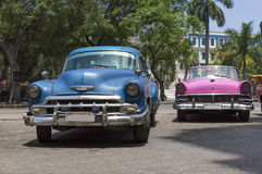 Cuban cars. A couple of old and colourful american cars parked in Parque Central, Old Havana, Cuba royalty free stock images
