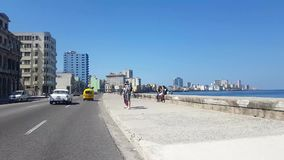 Cuban cars on the way in Malecon Havana stock video footage