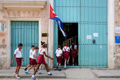 Cuban children entering a primary school in Havana Stock Photo