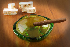 Cuban cigar. In ashtray glass royalty free stock photos