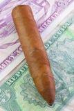 Cuban cigar and banknotes Royalty Free Stock Photography