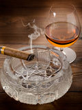 Cuban cigar and cognac Stock Photos