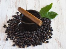 Cuban cigar and a Cup of Cuban coffee on a table. Cuban cigar and a Cup of Cuban plantation coffee on a wooden table stock image