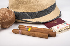 Cuban cigar and hat. Cuban cigars and hat on white royalty free stock photo