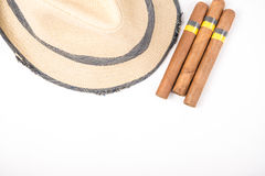 Cuban cigar and hat. Cuban cigars and hat on white Stock Photo