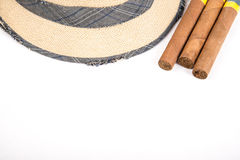 Cuban cigar and hat. Cuban cigars and hat on white Stock Photography