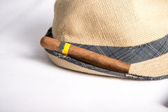 Cuban cigar and hat. Cuban cigars and hat on white Royalty Free Stock Images