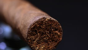 Cuban cigar isolated on black stock video
