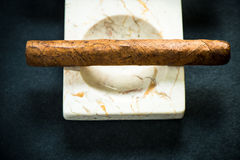 Cuban cigar in marble ash tray Royalty Free Stock Image