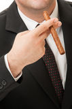 Cuban cigar, suit and tie Royalty Free Stock Images